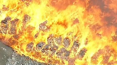 It took 11 days for fire fighters to bring the football field-sized fire under control.