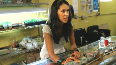 A 'budtender' in Boulder, Colorado, talks a customer through some of the marijuana products on offer.