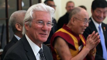 Actor Richard Gere accompanies the Dalai Lama during a meeting with members of the US Congress on Tuesday,