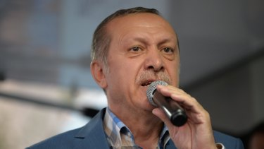 Turkish President Recep Tayyip Erdogan delivers a speech to his supporters in Istanbul after the failed coup.