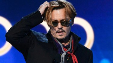 Here's Johnny! An apparently tired and emotional Depp presents the awards.