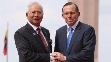 Tony Abbott with Najib Razak in Malaysia last year.