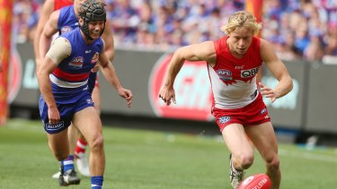 Breakout year: Isaac Heeney chases possession during the grand final against the Western Bulldogs.