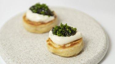 Caviar and creme fraiche on crumpets.
