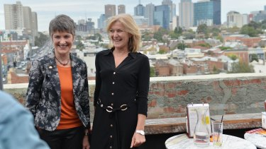 Meredith Doig and Fiona Patten on the rooftop of Brunswick Street bar Naked for Satan.