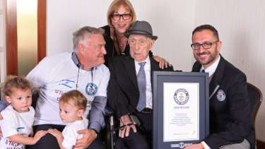 Israel Kristal with, from left to right, grandchildren Nevo and Omer, son Heim Kristal, and daughter Shula Kuperstoch, received the certificate from Guinness World Record's Marco Frigatti, right.