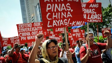 Anti China protesters rally against China's territorial claims in the Spratly islands in the South China Sea in front of the Chinese Consulate in Makati, Philippines in July.