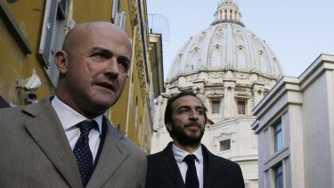 Italian journalists Gianluigi Nuzzi, left, and Emiliano Fittipaldi, have outlined divisions between Cardinal Pell and the Pope.