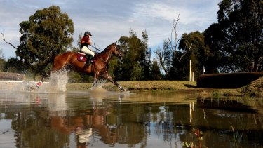 A rider on the cross-country course at the Sydney International Equestrian Centre. Parents of young riders say there is a sombre mood surrounding the sport.