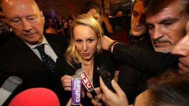 National Front regional leader Marion Marechal-Le Pen speaks to reporters after elections in France.