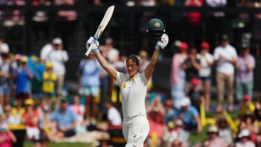 Cracking knock: Ellyse Perry salutes the crowd after reaching triple figures.