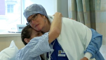 Natalie Turner hugs Dr Marci Bowers before the surgery.