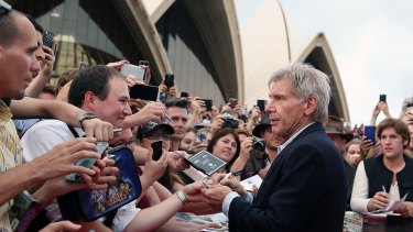 Harrison Ford attends the Star Wars: The Force Awakens fan event at Sydney Opera House on Thursday.