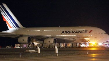 A child was found travelling on a Paris-bound flight without a ticket.