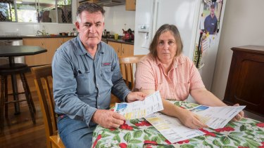 Jenny and Wally Jacobs looking at gas bills from their Melbourne unit.