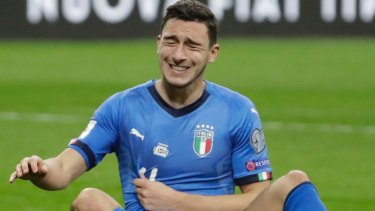 Down and out: Italy's Matteo Darmian.