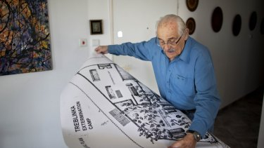 In this 2010 photo, Holocaust survivor Samuel Willenberg displays a map of Treblinka extermination camp.