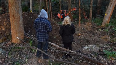 The parents of Matthew Leveson, Mark (left) and Faye (right) at the site in the Royal National Park at Waterfall.