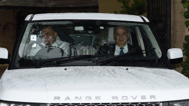 Eddie Obeid (right) leaves his home in Huntrs Hil this morning.