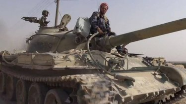 Rased News Network, a Facebook page affiliated with Islamic State militants, published this picture showing a militant on a tank captured from Syrian forces in Qaryatain.