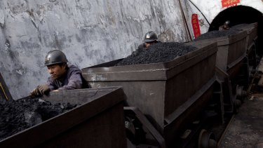 China has urged its domestic coal producers to cut output.