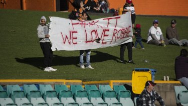 Confiscated: Tigers fans show their support for Farah.