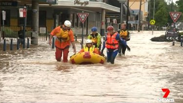 A man is rescued by SES swift water crews in Lismore.