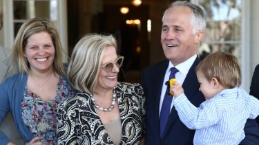 Mr Turnbull at Government House with his daughter Daisy, wife Lucy and grandson Jack.