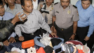 Indonesian police with drugs seized in 2005 which led to the arrest of the Bali Nine.