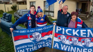 The Moore family pictured on grand final day outside their Braybrook home. From left: Chris Patmore and Nicole Moore, and Geoff and Irene Moore.