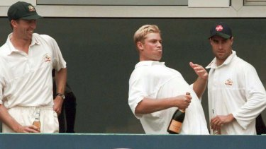 Australian bowler Shane Warne gestures to the crowd at Old Trafford, Manchester in his cricketing heyday.