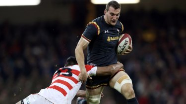 Wales Sam Warburton charges forward during the match against Japan.