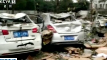 This image from video run by China's CCTV shows debris and damaged vehicles following an explosion in Ningbo in China.