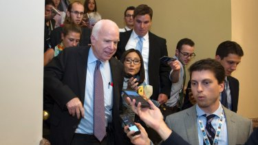 John McCain is pursued by reporters after casting a 'no' vote on a a measure to repeal parts of Obamacare.