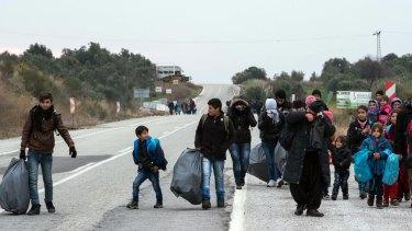 Migrants in Turkey en route to boats for Greece.