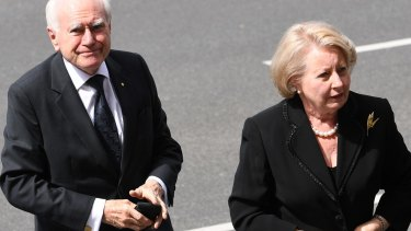 Former prime minister John Howard and his wife Janette arrive for the state funeral.