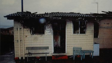 Photo copied from court documents shows the fire damage.