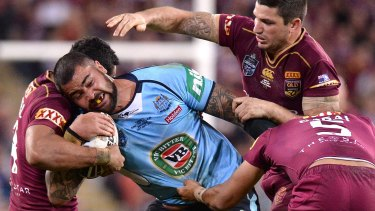 Man-mountain: Andrew Fifita carts the ball up.