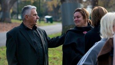 George Halvagis comforts the mother of Masa Vukotic, Natasha, at the sunrise vigil.