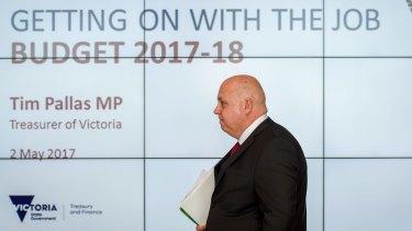 The Treasurer Tim Pallas handing down the budget.