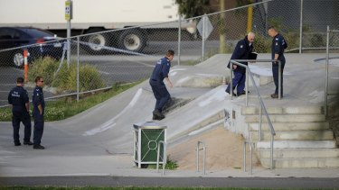 Police search the skate park in  Northcote the day after Tyler Cassidy was shot dead in 2008.