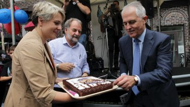 Ms Plibersek and Mr Turnbull pictured in 2014 while joining forces to celebrate a local event.