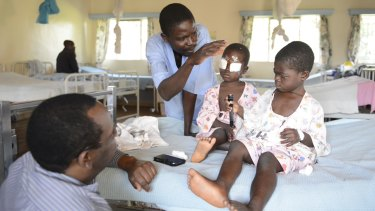 Kenyan children George, 4, and Alice, 5, after an operation to remove cataracts.