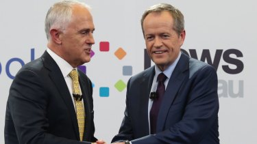 Prime Minister Malcolm Turnbull and Opposition Leader Bill Shorten shake at the Facebook debate.