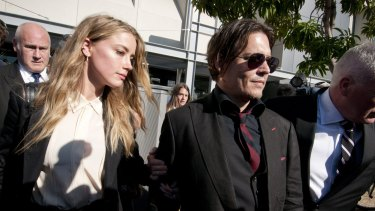 Depp leaving Southport Magistrates Court, Queensland, with Heard in April after she pleaded guilty to falsifying travel documents to sneak her dogs into Australia.