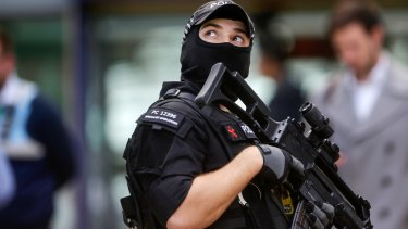 An armed police officer at Manchester Piccadilly railway station in Manchester.
