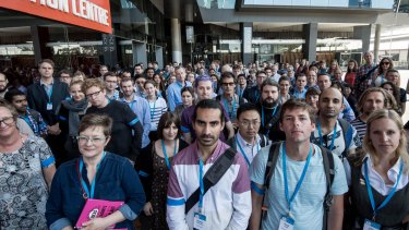 Scientists rally in Melbourne against cuts to climate change research at the CSIRO.