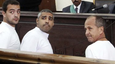 Journalists Baher Mohamed and Mohammed Fahmy, with Peter Greste, during a court appearance in Cairo in January.