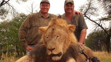 Walter Palmer, left, poses with the corpse of Cecil the lion. Cecil's death in 2015 reignited the debate over trophy hunting and conservation in Zimbabwe.