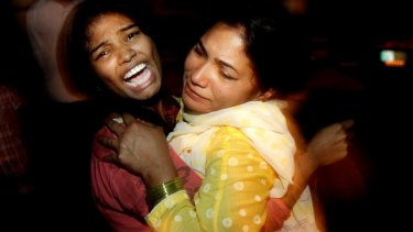 Comfort in a hug following a suicide bomb attack in Lahore.